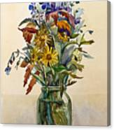 A Bouquet Of Wild Flowers In A Glass Jar. Canvas Print