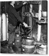 A Brewmeister Fills Kegs At A Bootleg Canvas Print
