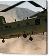A Ch-47 Chinook Helicopter Kicks Canvas Print