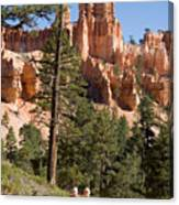 A Couple Hikes Along A Trail In Bryce Canvas Print