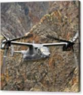 A Cv-22 Osprey Flies Over The Canyons Canvas Print