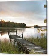 A Dock On A Lake At Sunrise Near Wawa Canvas Print