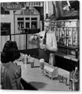 A Druggist Prepares Ice Cream Floats At A Soda Fountain Canvas Print
