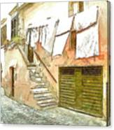 A Glimpse Of A House With Hanging Clothes Canvas Print