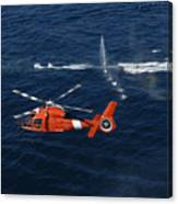 A Helicopter Crew Trains Off The Coast Canvas Print