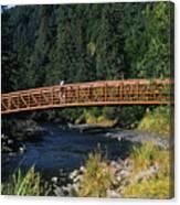 A Hiker Crosses A Bridge Canvas Print