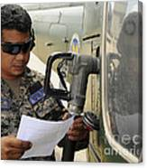 A Honduran Crew Chief Consults Canvas Print