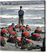 A Navy Seal Instructor Assists Students Canvas Print