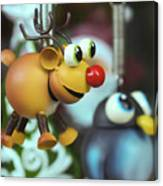 A Rudolph The Red Nosed Reindeer Ornament With A Penguin Canvas Print