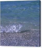A Small Wave Ripples Onto Shore Canvas Print