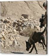 A Soldier And His Dog Search An Area Canvas Print
