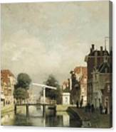 A Sunlit Canal With A Draw Canvas Print