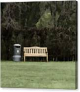 A Trash Can And Wooden Benches In A Small Grassy Area Canvas Print