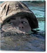 A U.s. Marine Swims Across A Training Canvas Print
