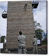 A U.s. Soldier Rappels Down A 40-foot Canvas Print