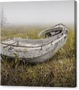 Abandoned Boat In The Grass On A Foggy Morning Canvas Print