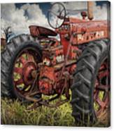 Abandoned Old Farmall Tractor In A Grassy Field Canvas Print