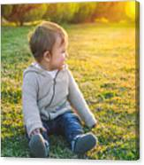 Adorable Baby Playing Outdoors Canvas Print