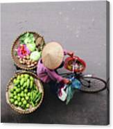 Aerial View Of A Vietnamese Traditional Seller On The Bicycle With Bags Full Of Vegetables Canvas Print