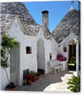 Alberobello Courtyard With Trulli Canvas Print