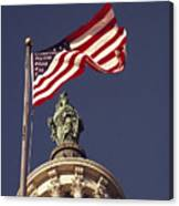 An American Flag And The Statue Canvas Print