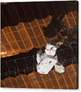 An Astronaut Anchored To A Foot Canvas Print