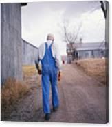 An Elderly Farmer In Overalls Walks Canvas Print