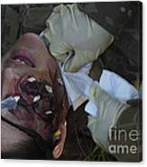 An Injured Patient Receives Medical Canvas Print