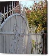 Angled Closeup Of White Washed Iron Gate To Garden Canvas Print