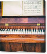 Antique Piano And Music Sheet Canvas Print