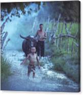 Asian Boy Playing Water With Dad And Buffalo Canvas Print