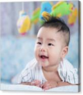 Asian Newborn Baby Smile In A Bed With Fish And Animal Mobile Canvas Print