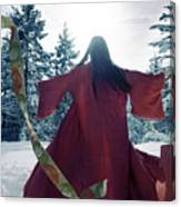 Asian Woman In Red Kimono Dancing In The Snow Spinning Around To Canvas Print