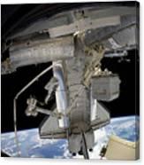 Astronaut Participates In A Spacewalk Canvas Print