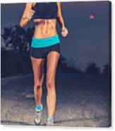 Athletic Woman Jogging Outdoors Canvas Print