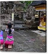 Bali Temple Women Bowing Panoramic Canvas Print