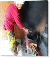 Balinese Lady Roasting Coffee Over The Fire Canvas Print