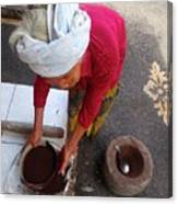 Balinese Lady Sifting Coffee Canvas Print