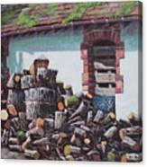 Barn With Log Pile Canvas Print