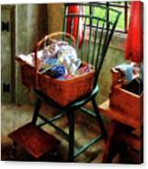 Basket Of Cloth And Yarn On Chair Canvas Print