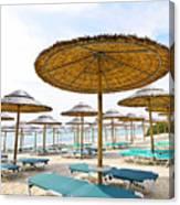 Beach Umbrellas And Chairs On Sandy Seashore Canvas Print