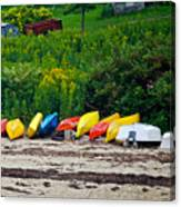 Beached Kayaks Canvas Print