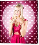 Beautiful Blonde Woman Gesturing Heart Shape Canvas Print