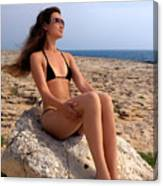 Beautiful Sexy Woman In Bikini Relaxing On A Rocky Seashore Canvas Print