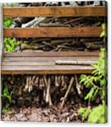 Bench And Wood Pile Canvas Print