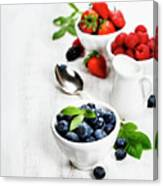 Berries In Bowls  On Wooden Background. Canvas Print