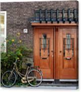 Bicycle And Wooden Door Canvas Print