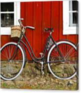 Bicycle In Front Of Red House In Sweden Canvas Print