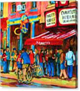 Biking Past The Deli Canvas Print