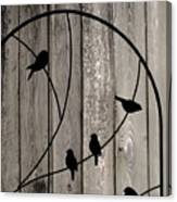 Bird Silhouettes On The Fence Canvas Print